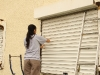 Carol cleaning the shutters
